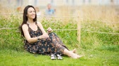instante : Cute woman relaxing in the park outdoors