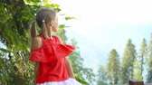 funicular : Beautiful happy little girl in mountains in the background of fog Stock Footage