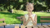 lábios : Little girl eating ice-cream outdoors at summer in outdoor cafe