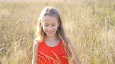 晴れた : Beautiful little blonde girl, has happy fun cheerful smiling face, red dress