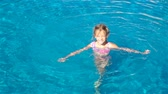 晴れた : Adorable little girl in outdoor swimming pool 動画素材