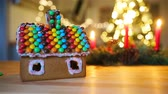 еда : Gingerbread fairy house on a background of bright Christmas tree with garland