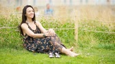 Cute woman relaxing in the park outdoors