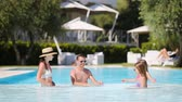 inflável : Happy family of four in outdoors swimming pool