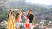 Young family in Positano village on the background, Amalfi Coast, Italy Dostupné videozáznamy