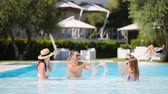 gonfiabili : Happy family of four in outdoors swimming pool