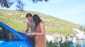 수하물 : Young couple tourist with map travelling by car