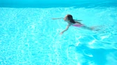 rosto humano : Adorable little girl swimming at outdoor swimming pool Stock Footage