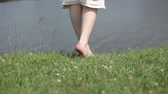 springtide : Girl near the river(FLAT COLOR) http:submit.123rf.comftpvideo_thumbnail.php?lang=en&thumb_fn=trekone150300152 Stock Footage