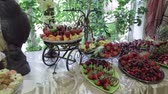 interior : Buffet table with pastries, cakes and fruits. Stock Footage