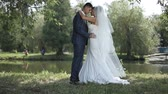 věčnost : beautiful newlyweds gently embrace. young couple in love . tenderness love