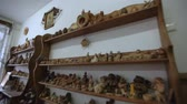сувениры : Workshop of folk art. On the shelves are clay products, souvenirs, dishes.Clay toys and souvenirs stand on the shelf.