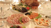 zastawa stołowa : Dishes with an appetizing cold snack on the festive table in the restaurant.