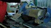 dimensão : plastic windows. Worker Cutting PVC Profile with Circular Saw.PVC windows and doors manufacturing.