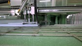 溶接機 : Line production of plastic windows. Plastic window frames move along the production line.