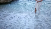 woman in white dress in the beach Stock Footage