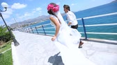 newlyweds are run along the embankment. Wedding day. Stock Footage