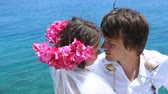 Newlywed happy young couple enjoying the sea during honeymoon Stock Footage