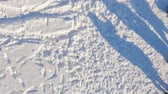 postroj : aerial view. The drone is spinning over a frozen lake and falls to the snow