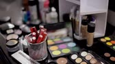 ruj : Professional cosmetics in the make-up salon. Luxurious cosmetics for make-up. Multicolored lipstick, shadows, powder, pencils close-up