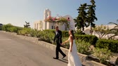 samimi : Happy newlyweds on the day of the wedding in the background of the hotel