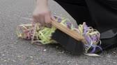 выпускного вечера : after party - woman cleaning the ground with hand brush and dustpan