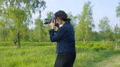 raised bog : Professional nature photographer taking pictures using a digital SLR camera - slow motion, ProRes