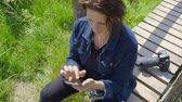 raised bog : Professional nature using smartphone and sending texts - ProRes