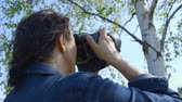 high plateau : Professional nature photographer, taking pictures, using a digital SLR camera - ProRes