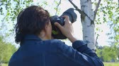 raised bog : Professional nature photographer, taking pictures, using a digital SLR camera - hand-held shot, ProRes