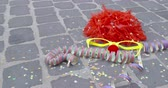 peruka : A funny wig, disguise glasses, a nose of foam material, streamers and a shower of confetti - carnival concept or celebration concept - ProRes