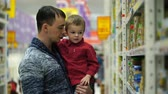 baby store : Footage father and son buys baby food in supermarket