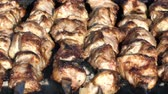 sausages : cooking shish kebab on the coals. Stock Footage