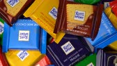 kukoricapehely : Samara, Russian Federation - August 13, 2018: Ritter sport chocolates mini rotate background. Ritter Sport - a popular German brand of chocolate, which is sold in many countries of the world
