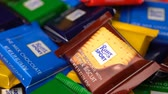 mısır gevreği : Samara, Russian Federation - August 13, 2018: Ritter sport chocolates mini rotate background. Ritter Sport - a popular German brand of chocolate, which is sold in many countries of the world. Stok Video