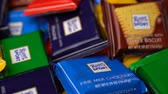 kukoricapehely : Samara, Russian Federation - August 13, 2018: Ritter sport chocolates mini rotate background. Ritter Sport - a popular German brand of chocolate, which is sold in many countries of the world. Stock mozgókép