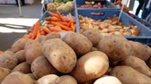 potato harvest : Farmers food market stall with a variety of organic vegetables for example, potatoes, onion carrots and more.
