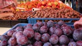 nogueira : Farmers food market stall with a variety of organic fruit for example, plums, nuts and apples.