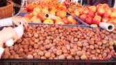 ореховая скорлупа : Farmers food market stall with a variety of organic fruit for example, hazelnuts, walnuts and apples.