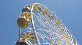 Ferris Wheel at amusement park. View from the bottom of a carousel, which rotates at a slow speed.