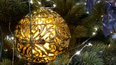 Christmas decorations on branch branches - tree branches with golden baubles Wideo