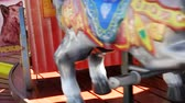 Childlike carousel in motion, in an amusement park.