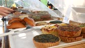 Bakery stand with pastries and cakes Wideo