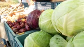 Farmers food market stall with a variety of organic vegetables for example, cabbage, onions, potatoes and others.