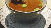 spiced : Bowl of Hot Georgian Soup Kharcho with Meat in restaurant