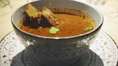 nogueira : Bowl of Hot Georgian Soup Kharcho with Meat in restaurant