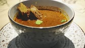 Bowl of Hot Georgian Soup Kharcho with Meat in restaurant