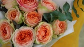tozlu : Wedding bouquet of bombastic roses and eucalyptus outdoors, girl dating, close up