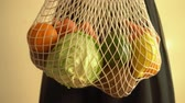 netting : Recycling mesh string bag full of vegetables and fruits, eco frindly no plastic concept 4k