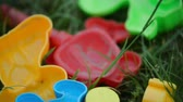 spades : Bright plastic childrens toys in the grass, sand set for baby, top Stock Footage